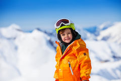 Portrait of smiling boy with ski mask and helmet Royalty Free Stock Photography