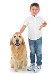 Portrait of smiling boy standing with his dog Stock Photo