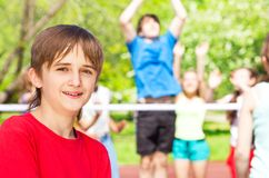 Portrait of smiling boy standing on playground Stock Images