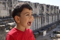 Portrait of smiling boy in the temple of Apollo. Royalty Free Stock Photo
