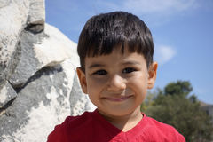 Portrait of smiling boy in the temple of Apollo. Stock Photos