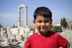 Portrait of smiling boy in the temple of Apollo. Stock Photo