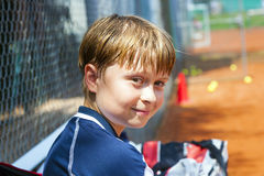 Portrait of a smiling boy at a tennis court Stock Photo