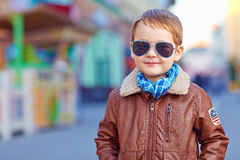 Portrait of smiling boy walking on the street Royalty Free Stock Photo