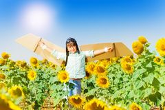 Cute boy aviator playing in sunflower field Stock Images