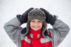 Portrait of smiling boy in winter clothes stock images