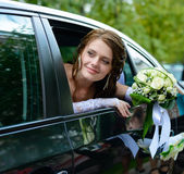 Portrait smiling bride in a car window Royalty Free Stock Image