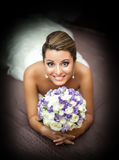 Portrait of smiling Bride holding a bouquet of flowers Stock Photos