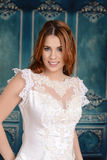 Portrait of smiling bride in lace dress Stock Image