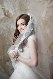 Portrait of the smiling bride with perfect make up Stock Photos