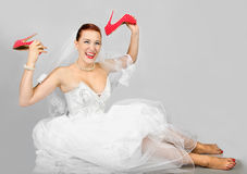 Portrait of smiling bride with  red shoes Royalty Free Stock Photography