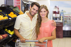 Portrait of smiling bright couple buying food products Royalty Free Stock Photos