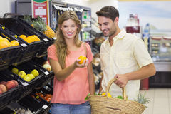 Portrait of smiling bright couple buying food products Stock Photo