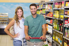 Portrait of smiling bright couple buying food Royalty Free Stock Image