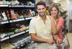Portrait of smiling bright couple buying products Royalty Free Stock Image