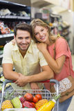 Portrait of smiling bright couple buying products Stock Photos