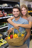 Portrait of smiling bright couple buying vegetables Stock Images
