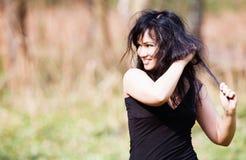 Portrait of smiling brunette Stock Photo