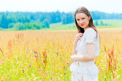 Portrait of a smiling brunette in the field Stock Photo