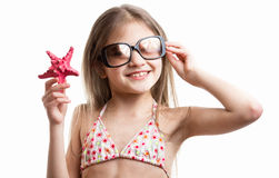 Portrait of smiling brunette girl posing with red starfish Royalty Free Stock Photos