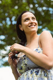 Portrait of a smiling brunette holding her braid Royalty Free Stock Photography