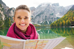 Portrait of smiling brunette at Lake Bries holding map Royalty Free Stock Photos
