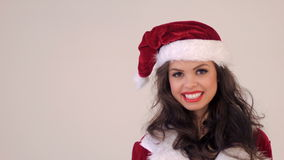 Portrait of Smiling Brunette in Santa Claus Costume Royalty Free Stock Photos