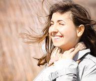 Portrait of a smiling brunette in windy day Stock Photography