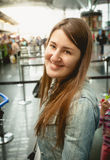 Portrait of smiling brunette woman standing at queue in airport Royalty Free Stock Photos