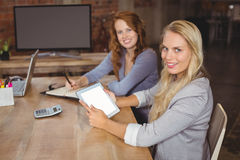 Portrait of smiling business colleagues posing Stock Photography