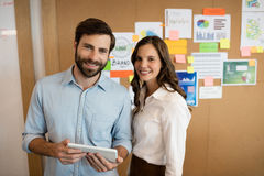 Portrait of smiling business colleagues working on digital tablet Royalty Free Stock Photography