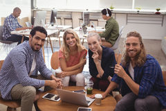 Portrait of smiling business colleagues working at office Stock Image