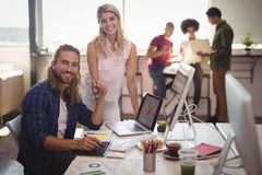 Portrait of smiling business colleagues working together at creative office Stock Image