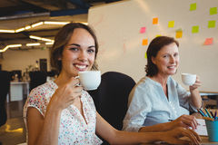 Portrait of smiling business executives having cup of coffee Stock Photography