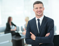 Portrait of a smiling business man with colleagues working in th. Face of handsome businessman on the background of business people Royalty Free Stock Photos