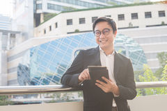 Portrait of smiling business man look confident using computer tablet Stock Images