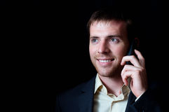 Portrait of a smiling business man talking mobile Stock Photography