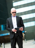 Portrait of smiling business man using computer tablet. Royalty Free Stock Photo