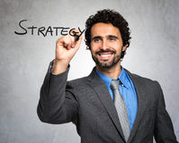 Portrait of a smiling business man writing strategy on the screen Royalty Free Stock Photography