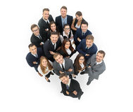 Portrait of smiling business people against white background Royalty Free Stock Images