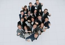 Elevated view of large group of multiethnic business people chee Stock Image