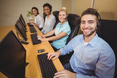 Portrait of smiling business people in call center Stock Photography