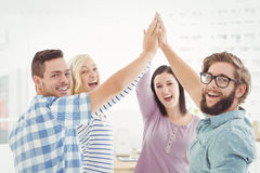 Portrait of smiling business people giving high five Royalty Free Stock Images
