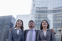 Portrait of smiling business people in a row outdoors, Beijing Royalty Free Stock Photo