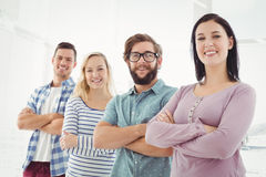 Portrait of smiling business people standing in row with arms crossed Royalty Free Stock Photography
