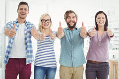Portrait of smiling business people with thumbs up Royalty Free Stock Photo