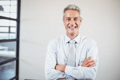 Portrait of smiling business professional with arms crossed Royalty Free Stock Photos