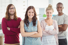 Portrait of smiling business team with arms crossed. At office Royalty Free Stock Photo