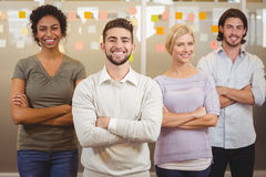 Portrait of smiling business team with arms crossed in office Royalty Free Stock Photos