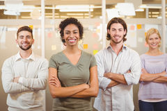 Portrait of smiling business team with arms crossed in office Royalty Free Stock Image